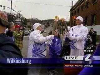 As the Olympic flame made its way to Salt Lake City for the 2002 Games, Joe DeNardo carried the torch in Wilkinsburg and passed it to Pittsburgh Penguins owner Mario Lemieux, another well-known cancer survivor.
