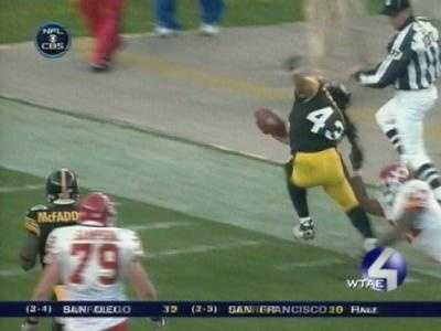 Kansas City running back Larry Johnson uses Troy Polamalu's long hair to make a tackle after an interception.