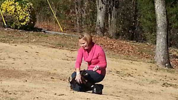 Dana Roberts, an attempt survivor, plays with her Chihuahua mix puppies.