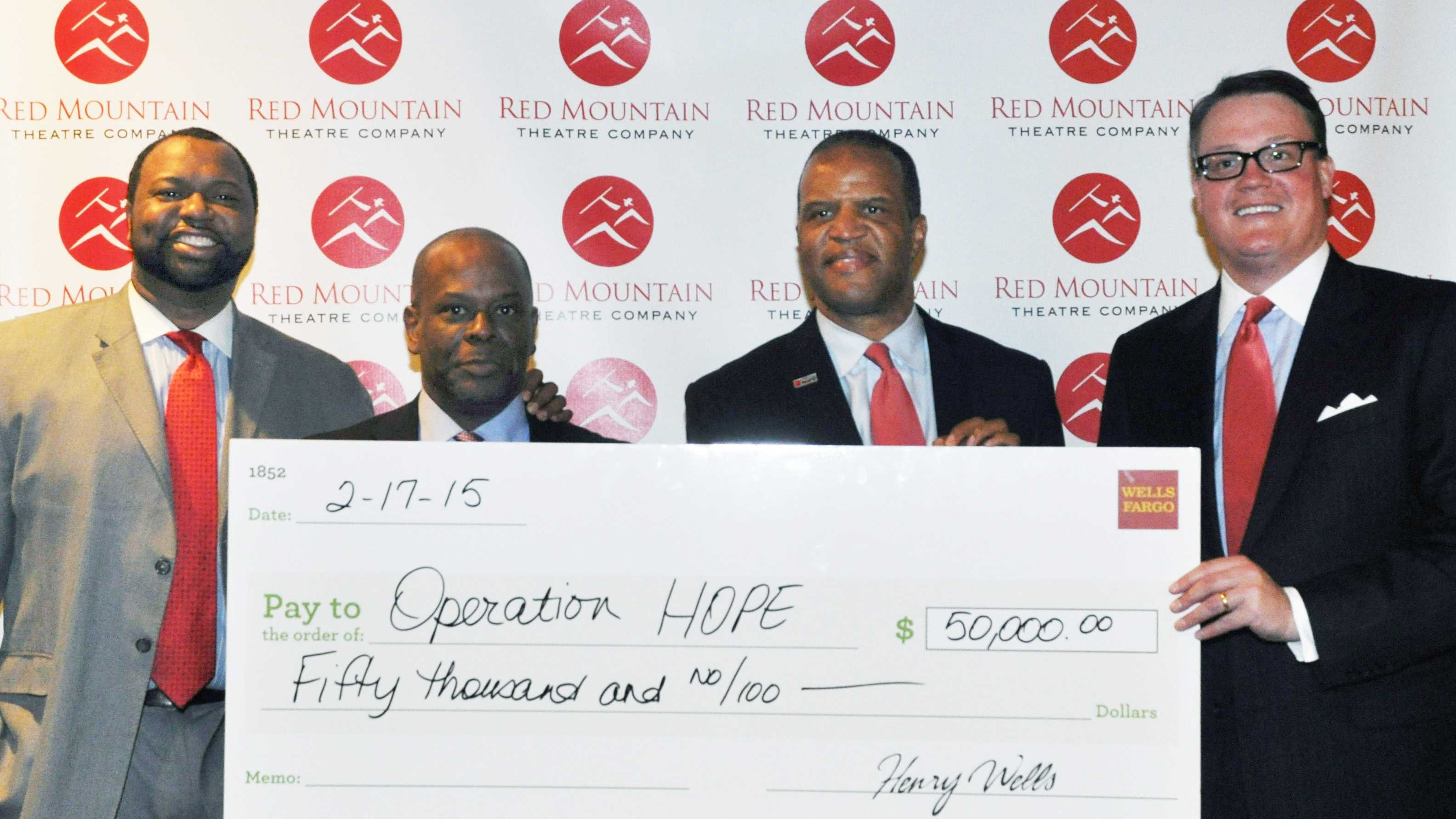 Left to right: Jay Bailey, Operation HOPE Southeast region CEO&#x3B; Richard Busby, Wells Fargo senior community development officer&#x3B; John Hope Bryant, Operation HOPE founder, chairman and CEO&#x3B; and George Trible, Wells Fargo area president.  On Tuesday, Wells Fargo presented Operation HOPE with $50,000 to bring a Small Business Empowerment Program to Birmingham.