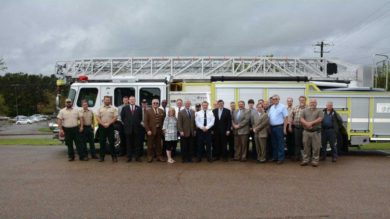 AFC associates and members of the Sumiton VFD stand with the new truck, along with Assistant State Forester Dan Jackson, Walker County Commission Chairman Billy Luster, Walker County EMA Coordinator Regina Myers, State Senator Greg Reed, Sumiton VFD Chief David Waid, State Representative Tim Wadsworth, State Forester Greg Pate, U.S. Congressman Robert B. Aderholt's District Field Director Paul Housel, and Walker County Fire Association President Terry McCullar.