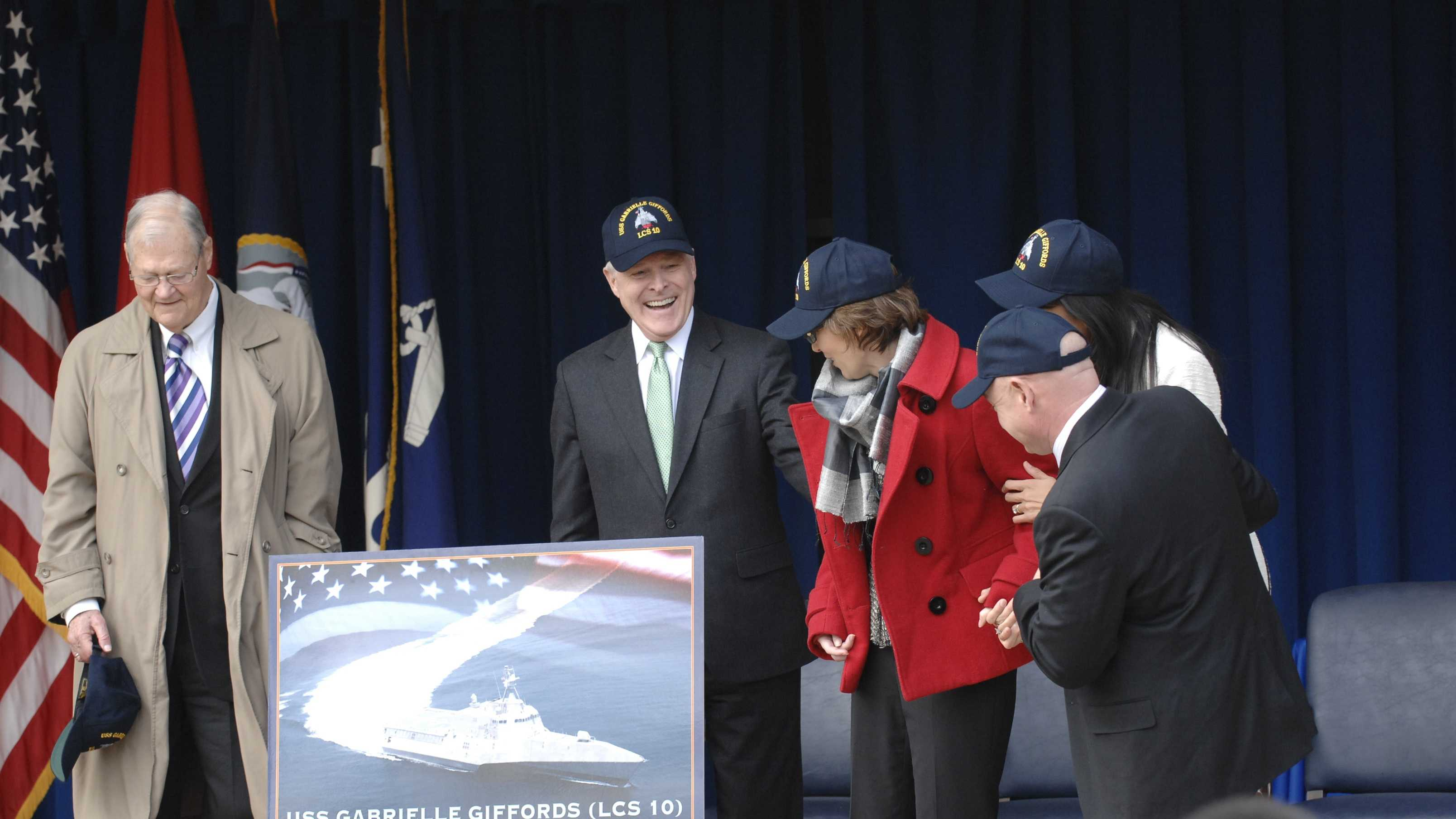 Former U.S. Rep. Gabrielle Giffords, of Arizona, center-right, admires a picture depicting the USS Gabrielle Giffords, the Navy's fifth Independence variant littoral combat ship, which Navy Secretary Ray Mabus, center, unveiled during an event at the Pentagon, Feb. 10, 2012. Giffords' husband, retired Navy astronaut Mark Kelly, front-right, former Missouri Rep. Ike Skelton, far left, and Roxanna Green, mother of Christina-Taylor Green, who was killed during the same event in which Giffords was shot, also attended the ceremony. DOD photo by Army Sgt. 1st Class Tyrone C. Marshall Jr.