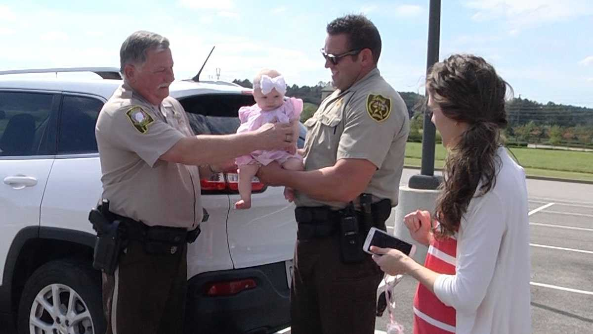 Deputies Ric Lindley and Tim Sanford reunite with Monica Johnson and her daughter, Aubrie Ella. A photo of Aubrie Ella and Lindley at a wreck scene Tuesday went viral