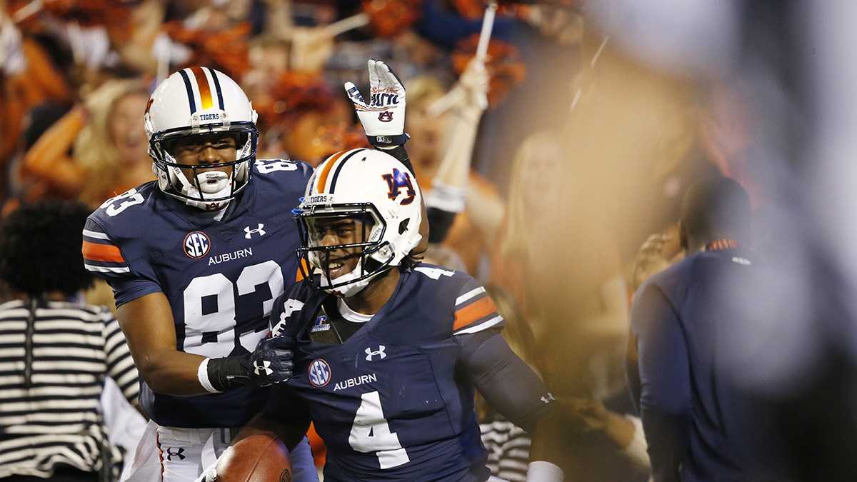 Auburn wide receiver Jason Smith (4) celebrates with Auburn wide receiver Ryan Davis (83) after scoring a touchdown during the second half of an NCAA college football game against Alabama, Saturday, Nov. 28, 2015, in Auburn, Ala.