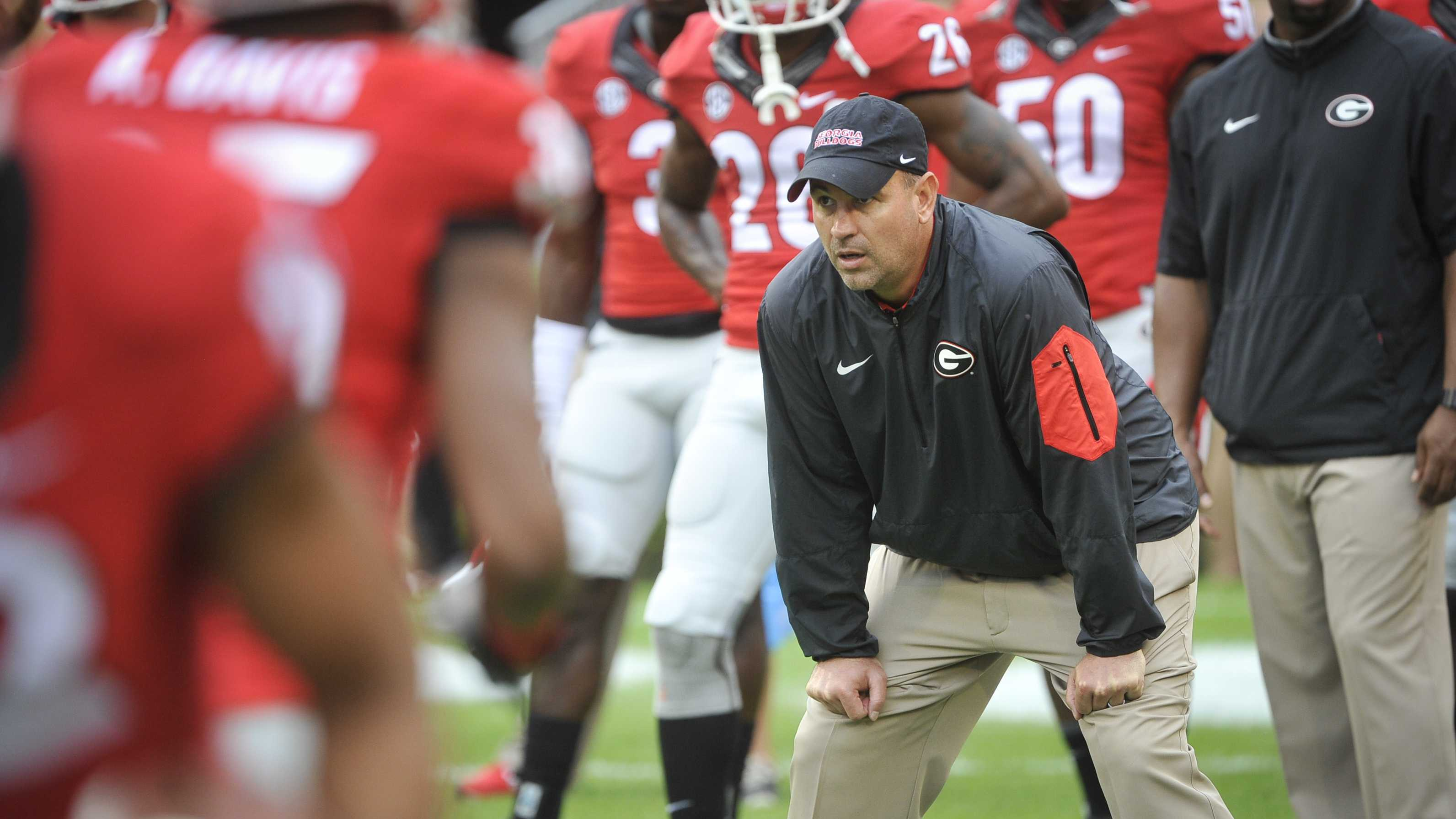 Georgia defensive coordinator Jeremy Pruitt watches warmups before an NCAA college football game against Kentucky Saturday, Nov. 7, 2015, in Athens, Ga. Georgia won 27-3.