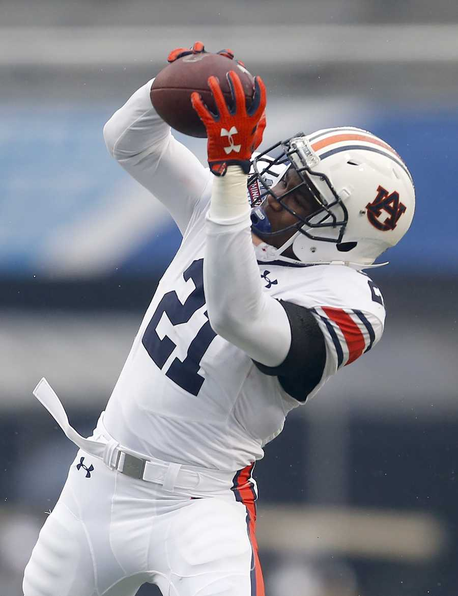 Auburn running back Kerryon Johnson (21) catches a pass on a fake punt before he carried it for the first down during the first half of the Birmingham Bowl NCAA college football game against Memphis, Wednesday, Dec. 30, 2015, in Birmingham, Ala.