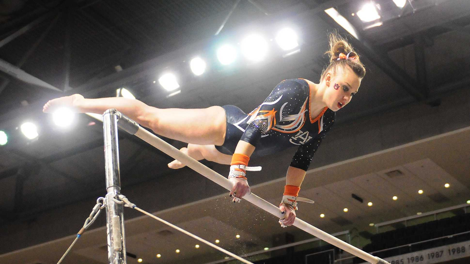 The No. 7 Auburn gymnastics team defeated No. 21 Kentucky 196.275–195.175 at the home and SEC opener Friday at Auburn Arena.