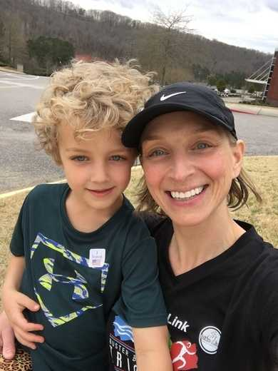 Meteorologist Stephanie Walker (and son) cast their votes.