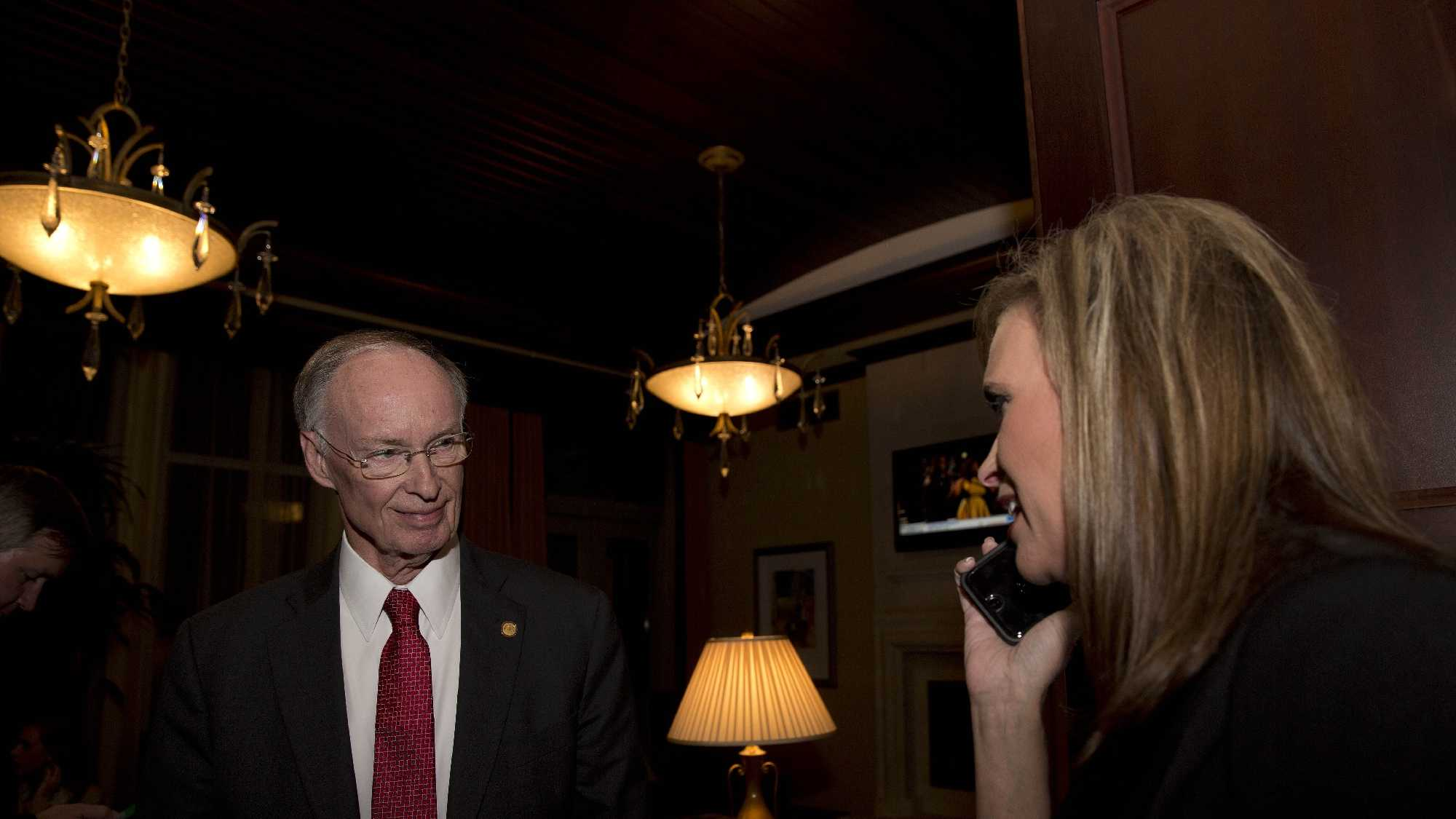 Republican Gov. Robert Bentley takes the phone call from Rebekah Mason announcing his win for Alabama governor, Tuesday, Nov. 4, 2014, in Montgomery, Ala. Bentley defeated his opponent Democrat Parker Griffith.