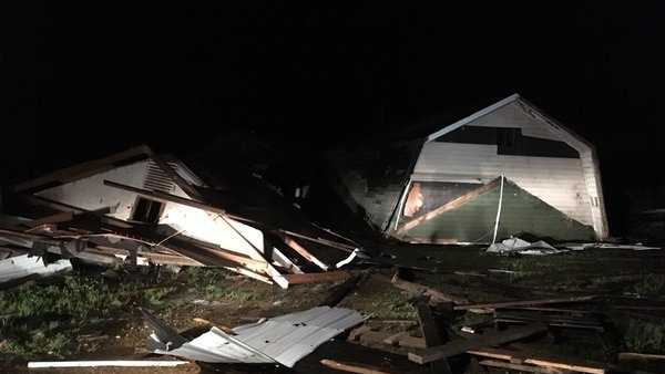 A dairy barn that suffered damage after a tornado touched down March 31 off County Road 52 in Fayette.