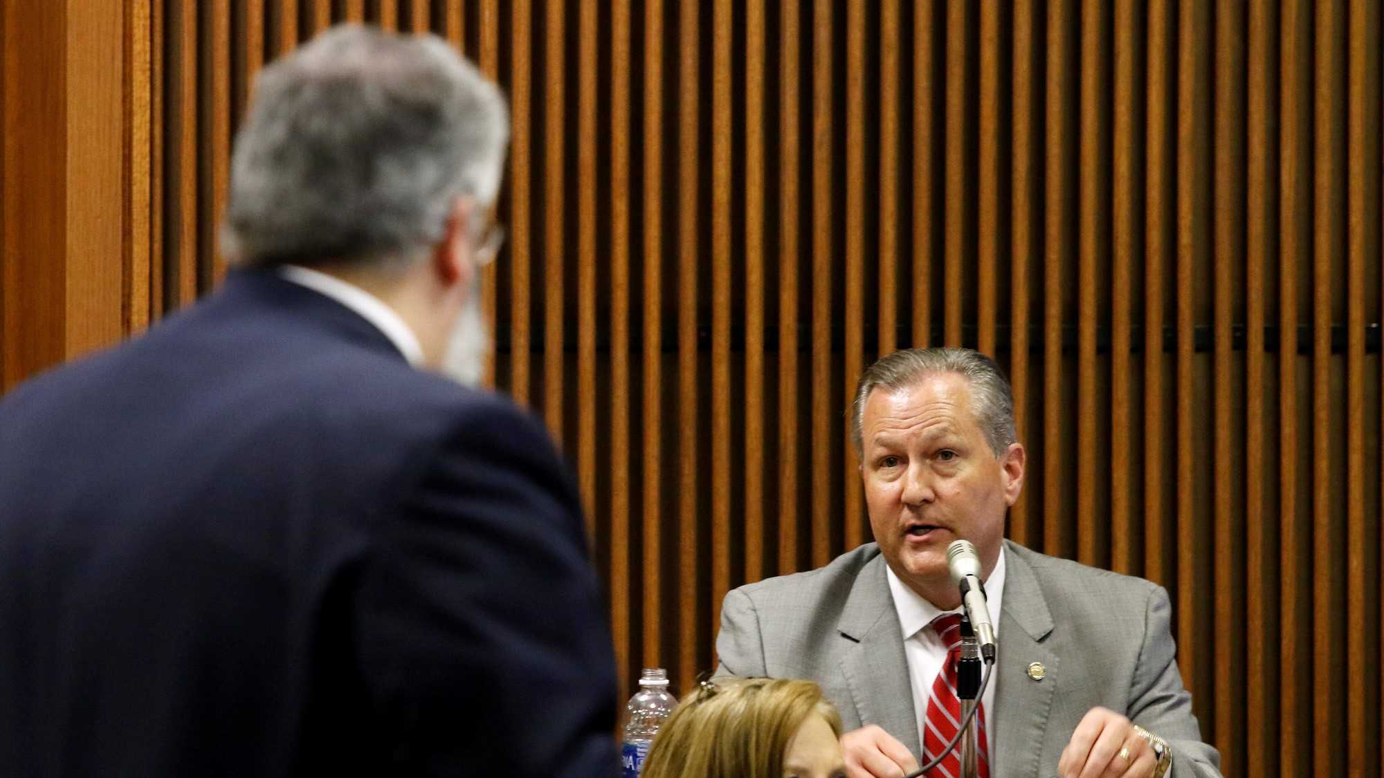 Mike Hubbard answers questions from Deputy Attorney General Matt Hart on Wednesday, June 8, 2016 in Opelika, Ala.