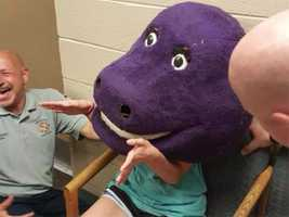 """""""When she first got there, we looked at it and it was tight,"""" said Lt. Vince Bruno of Trussville Fire and Rescue. """"It had come down around her shoulders and was holding her arms, which looked kind of like dinosaur arms because she could bend from the elbows down, and it was little comical."""""""