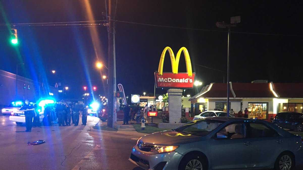 A man crashed his car near a Birmingham McDonald's on Wednesday night after being shot.