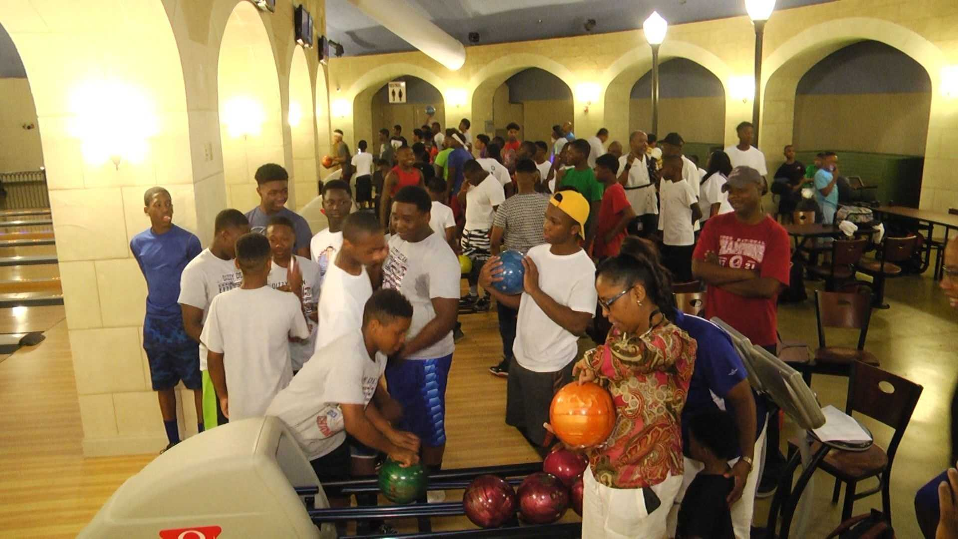 Birmingham youths enjoy a bowling game at a mentoring session with police officers.