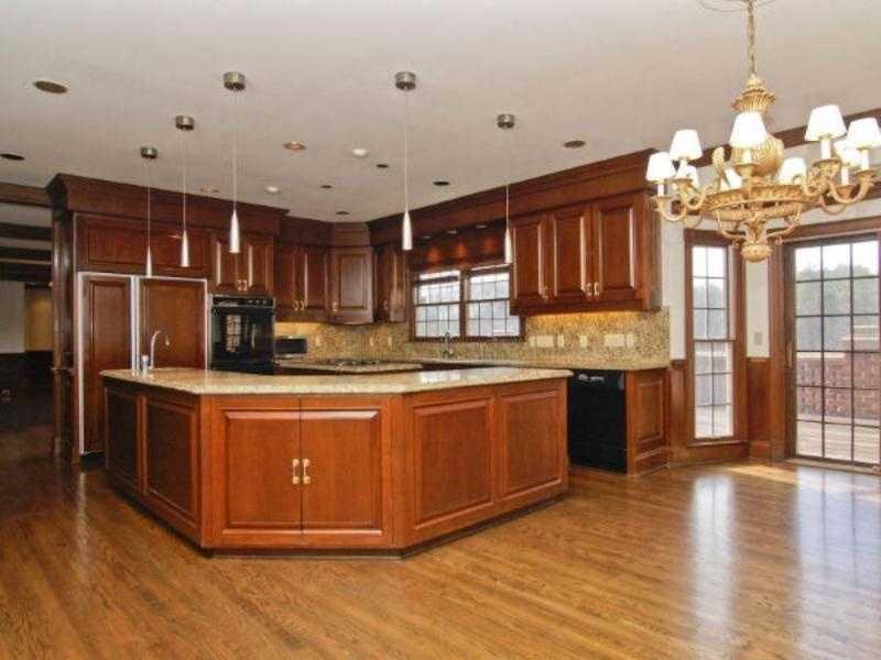Spacious Kitchen with custom mahogany cabinetry