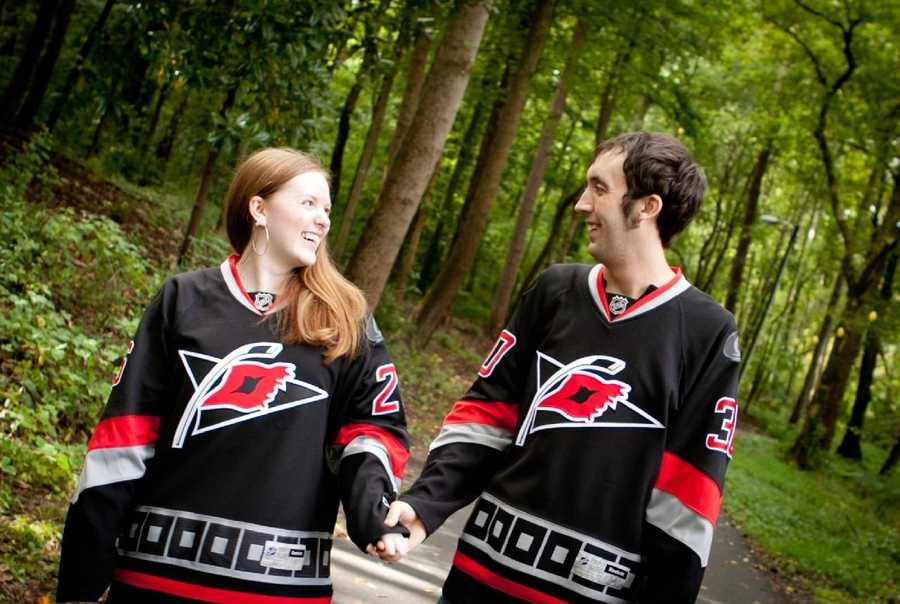 This couple really loves their favorite hockey team. Great sports themed engagement photo.