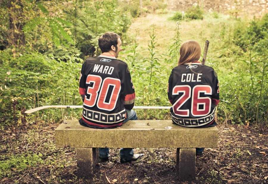 Cute photos with the couples favorite hockey player's number and team shirts makes a cool save the date photo.