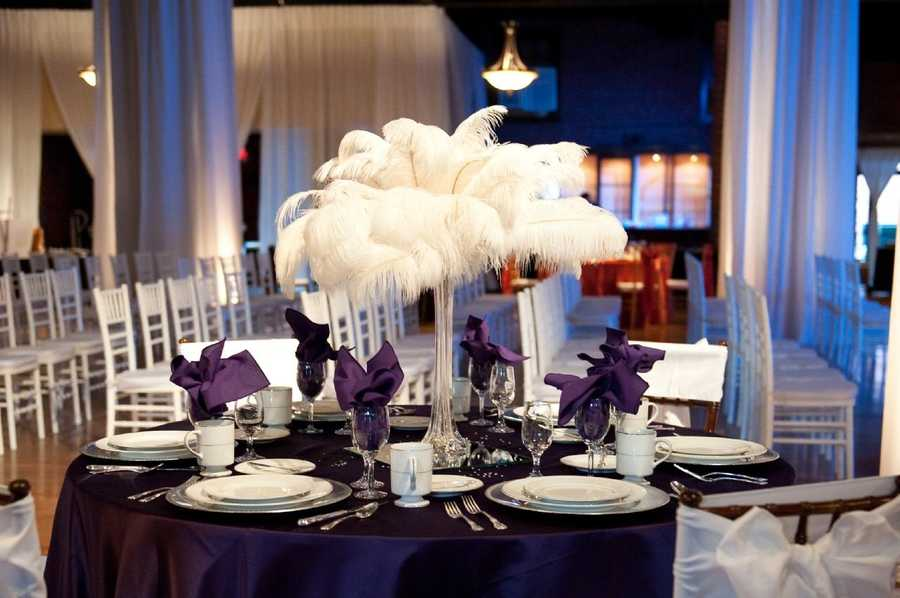 "Feathers are great for decorating with for the Hollywood themed wedding and ""The Great Gatsby."" Remember it doesn't always have to be gold or silver colors decorating the table. Use your wedding colors you want."