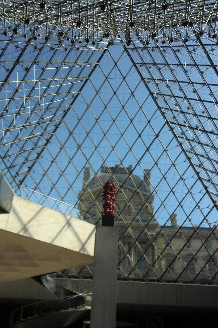 The Louvre Pryamid inside of the Museum in Paris, France