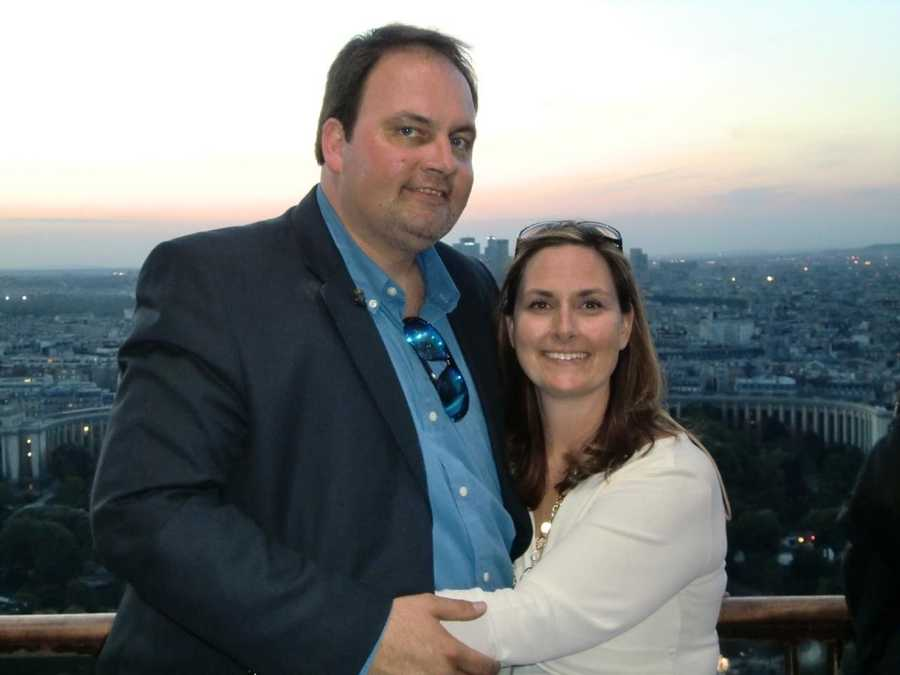 Austin and Angela Caviness on top ofThe Eiffel Tower in Paris, France.