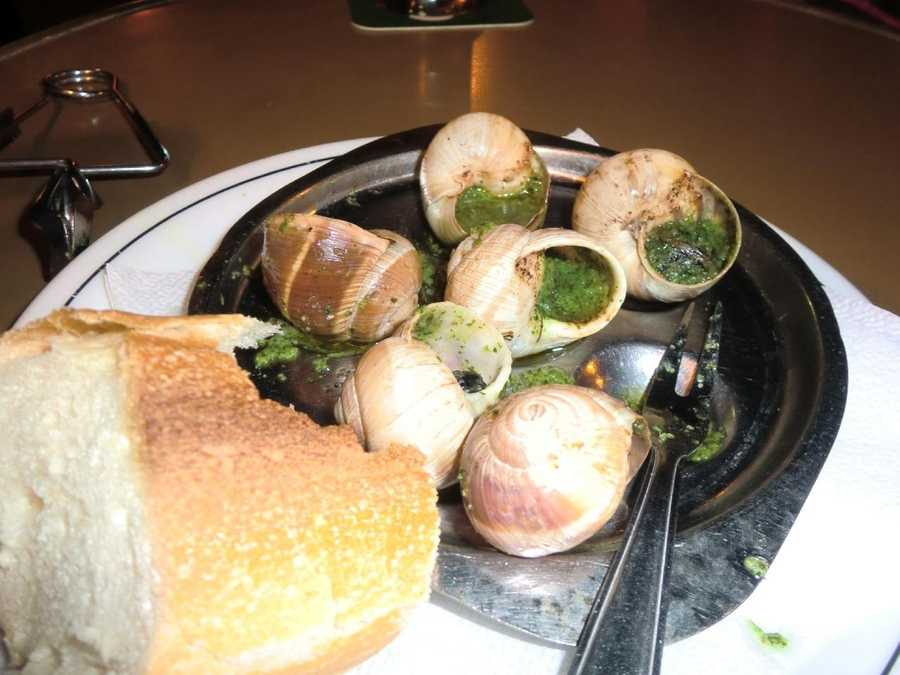Austin tries Escargot for the first time in Paris, France.