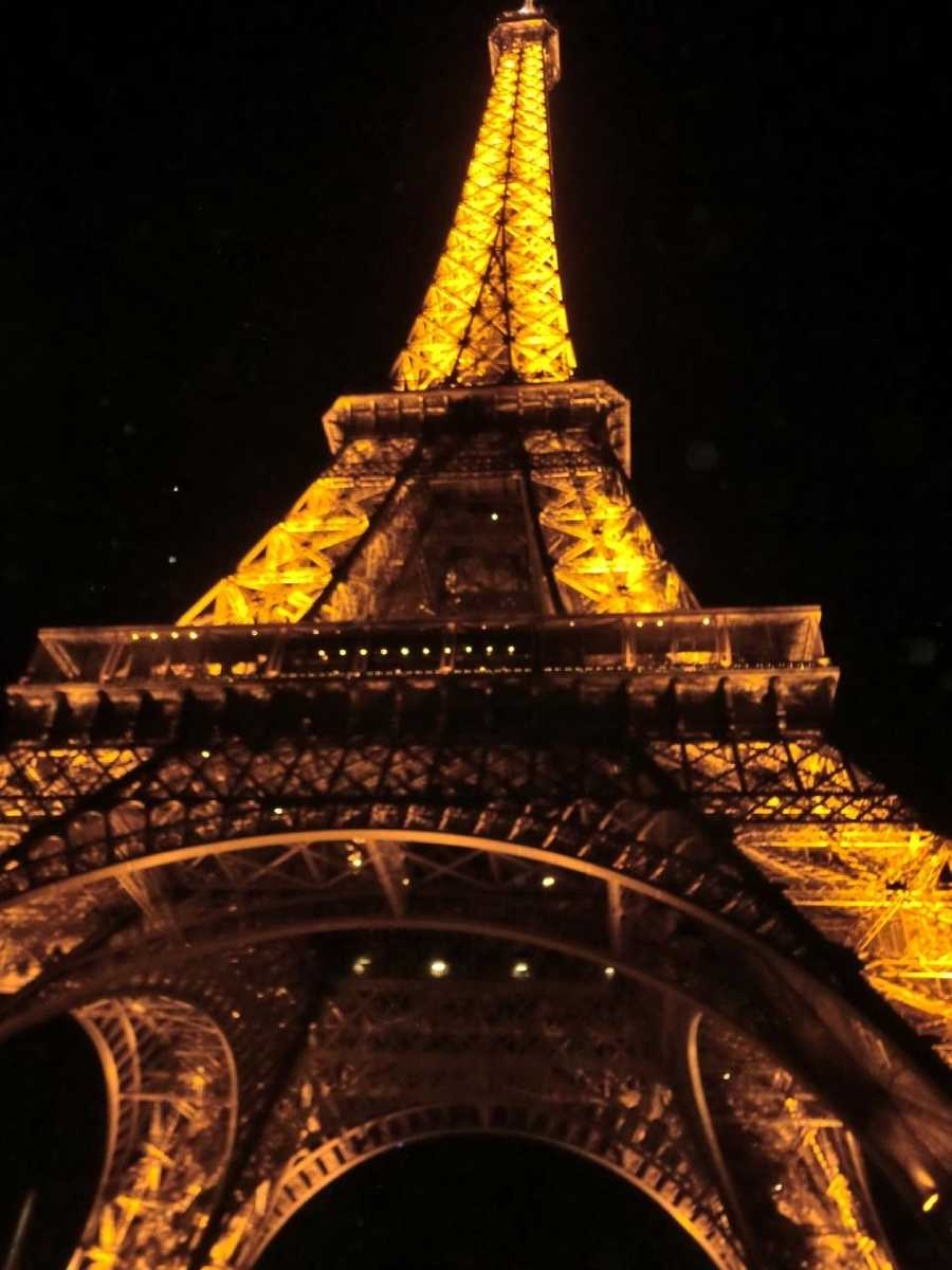The Eiffel Tower makes for a romantic night out for the newlyweds on their honeymoon in Paris, France.