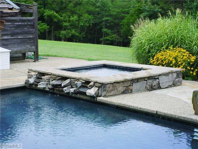 Heated Pool with retractable cover are located near the Pool House