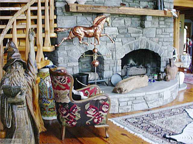 The home's fireplaces are located in the living room and the den