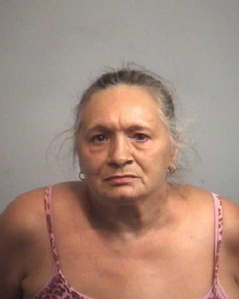 Kathleen Reed, 57: Charged with larceny.
