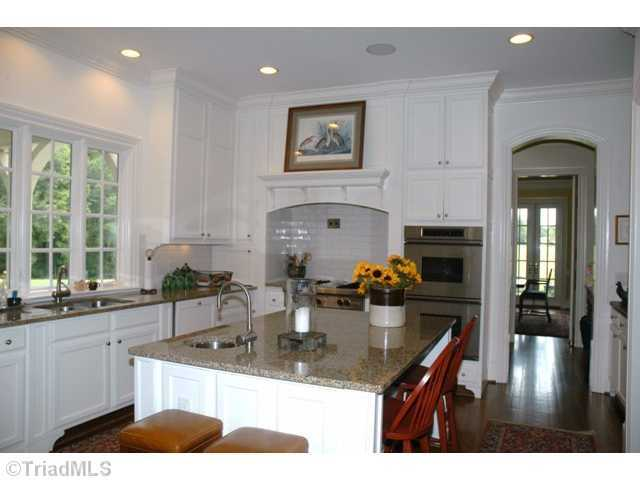 Gourmet Kitchen with floor to ceiling custom cabinets
