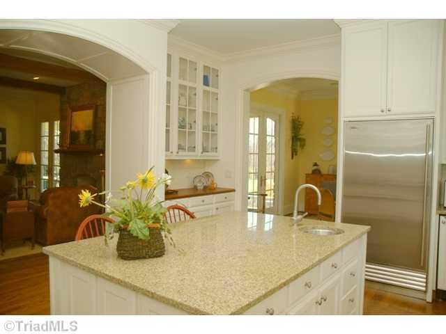 From the Kitchen, archways open to the Great Room, Dining Room and Breakfast Room
