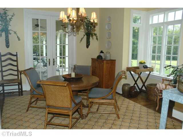 Breakfast Room with french doors that open to the back yard and loggia