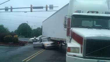 Car partially underneath tractor-trailer (WXII)