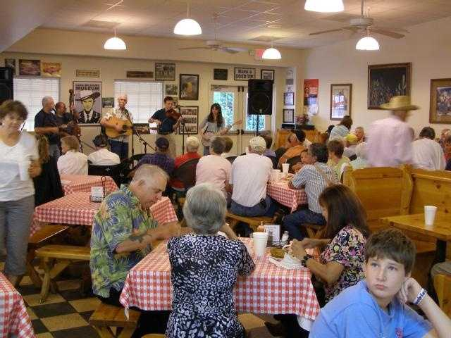 On Thursday & Saturday nights, Prissy Polly's has live music in-store. Customers fill the seats for some good music and great food!