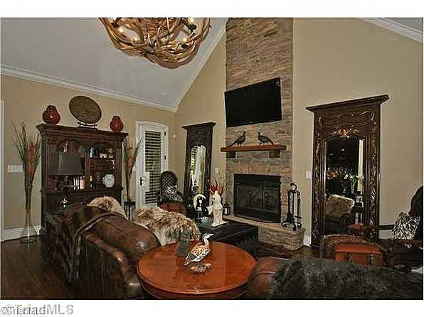 Great Room with a floor to ceiling stone fireplace