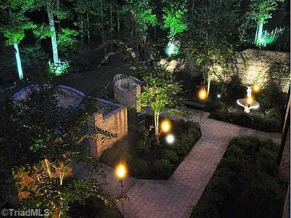 Exterior lighting highlights the landscape
