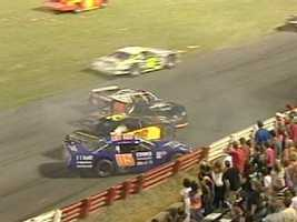 Since 1949, Bowman Gray Stadium in Winston-Salem has provided weekly races around its quarter-mile track. Always popular, the track's attendance soared when the 'Madhouse' races were featured on cable TV.