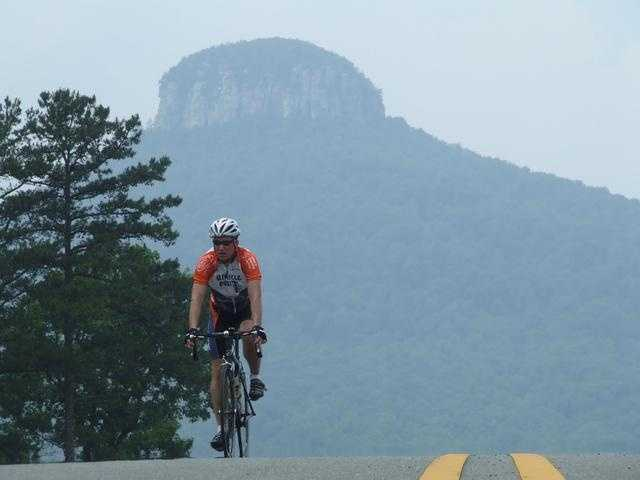 The distinctive pinnacle of Pilot Moutain stands out as one of NC's most beautiful landscapes. Pilot Mountain's state park is one of the state's top spots for hiking, biking, camping, and rock climbing.