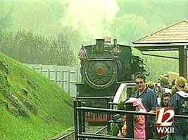 At Tweetsie Railroad, you can take a ride on an authentic steam locomotive. The park has several other amusement rides, games, and a Wild West show with cowboys and Indians!