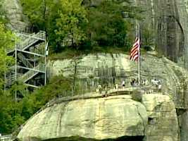 Check out the breathtaking view atop Chimney Rock State Park! Hiking trails for all levels of run throughout the park. There's also shopping, dining, and rock climbing.