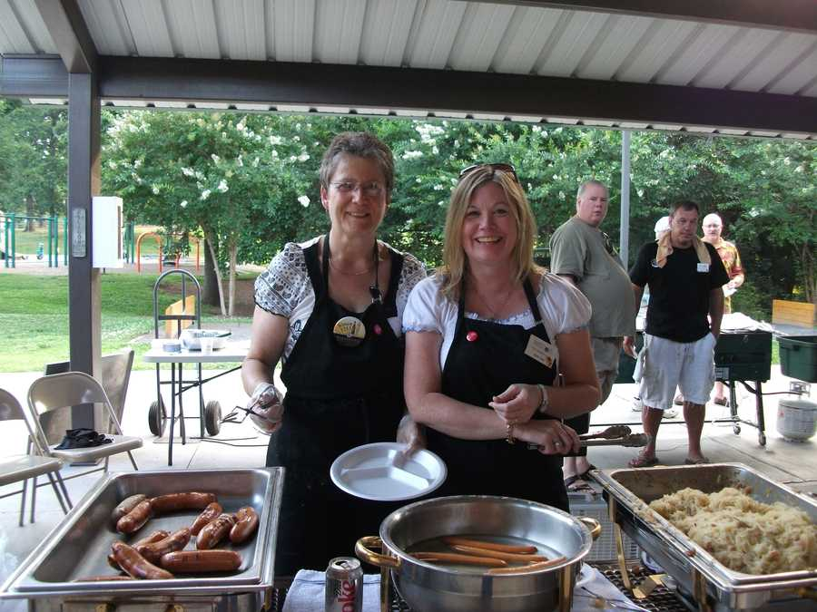 The ladies from the Triad German Club served food while the men cooked it. Bratwurst, knockwurst, bockwurst were served with sauerkraut, spicy mustard and buns and a side of German potato salad.