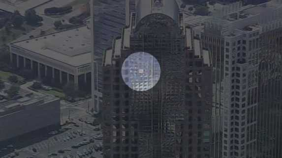 Broken window at Charlotte skyscraper (Image from WCNC/spot shadow added by WXII)