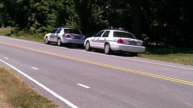 Police surrounded a home on Old Hollow Road during a search for a suspect in a reported rape. (William Bottomley/WXII)