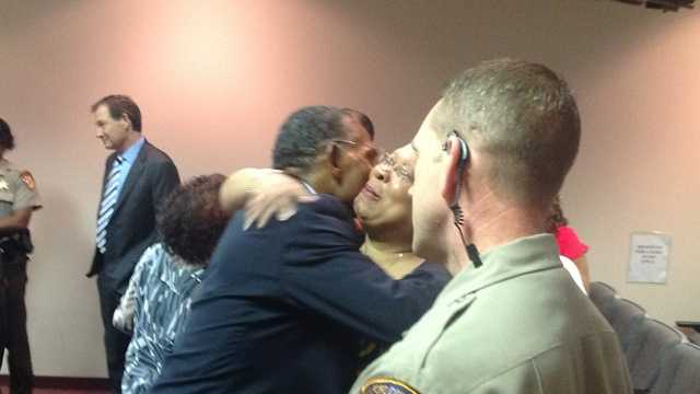 Lamont Armstrong gets hugs after being told he can walk away as a free man. (Bill O'Neill/WXII)
