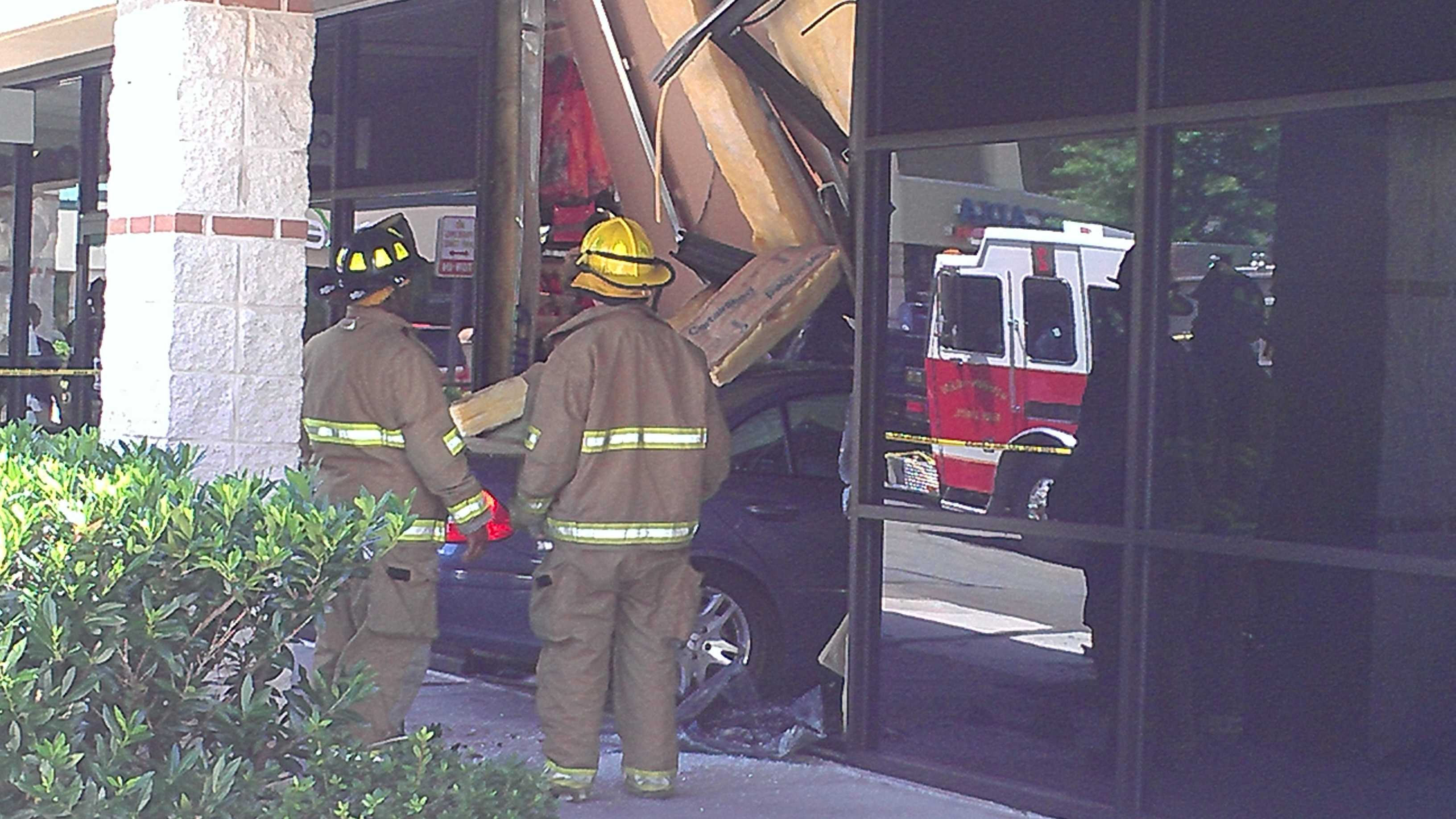 A car hit several cars in a parking lot before crashing through a storefront window in Winston-Salem Friday afternoon. (Photo by WXII's Doug Miller)