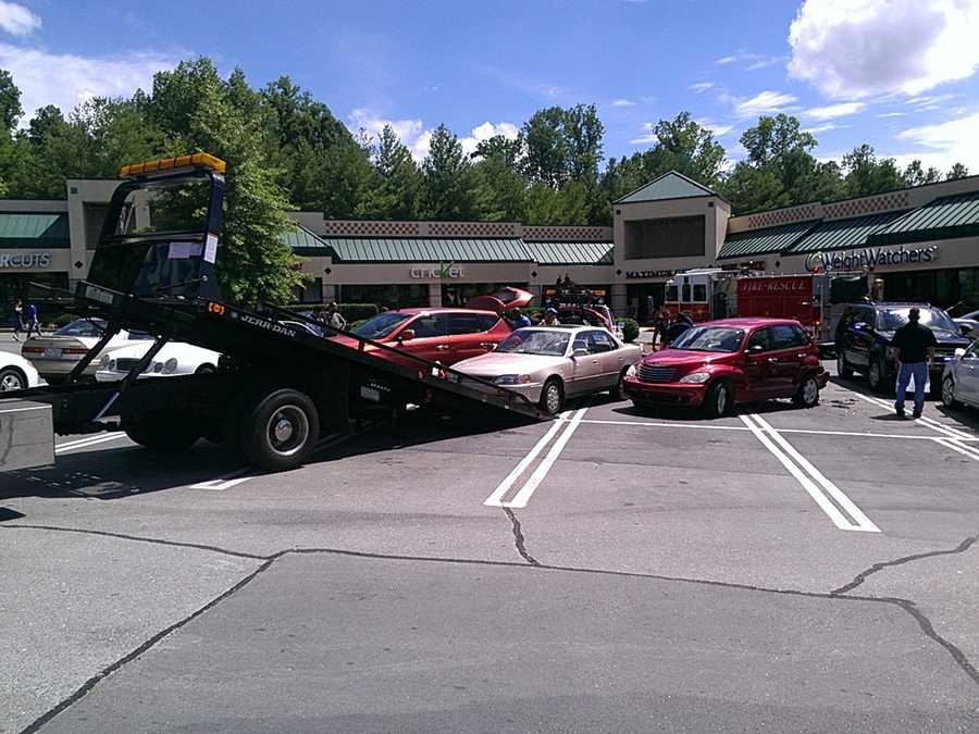 Wreckers take out the vehicles hit by the Mercedes. (Ericka Miller/WXII)