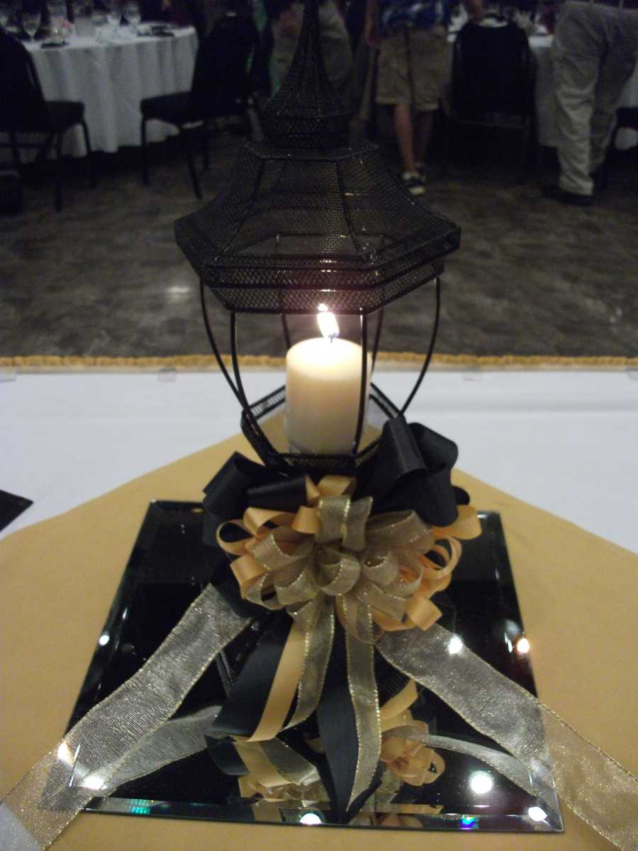 A table was set up in memory of those in band that had passed away. The candle was lit and a brief word was said as the names were read. A black and gold band helmet was placed on one side of the candle, along with a framed list of all those lost.