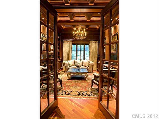 Study with with beautiful woodwork and a coffered ceiling