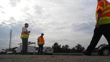 Crews sweeping up loose rocks on I-40 (Joey McDonald/WXII)