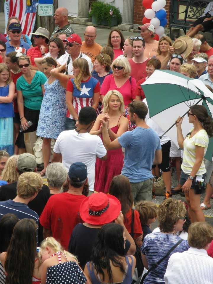 """The town of Southport hosted a July 4 """"parade"""" on Wednesday as part of a movie shoot that included actress Julianne Hough. In this photo, Hough walks through the crowd."""